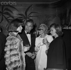 1964 - El Moroccan Night. New York: Cafe society congregates at El Morocco for the official reopening of the famed supper club under the ownership of London's John Mills. Among those on hand were Porfirio Rubiroso and his French actress wife Odile Rodin (left), Mrs. Denniston Slater and actress Constance Bennett.