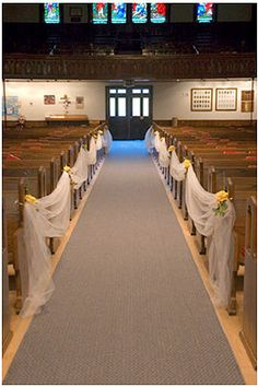 simple pew markers w/tulle. Keeps people from walking down the aisles before the wedding party