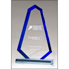Flame series blue acrylic with blue accented bevel - 3/4 thick blue acrylic.   This award comes with your special message. Ideal as recognition awards to put on display at work or at home. With a sizeable engravable area that can be personalized with a logo, crest and wording to mark a sales achievement, sporting success, Church/Religious Recognition or just to acknowledge a job well done.