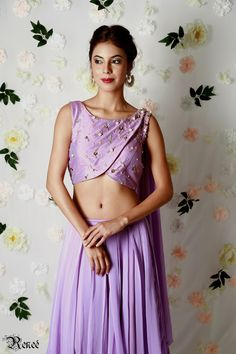 Lavender pleated lehenga, overlap blouse with an attached draped dupatta by Renee label