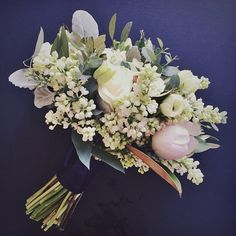 Pale pink peonies, lilac, and dusty miller