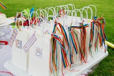 Love this idea for the party favor/pinata treats bag. Need to find rainbow ribbon