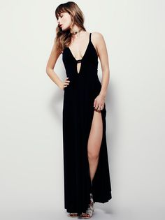 Lights And Music Knit Maxi | Stunning maxi dress featuring an effortless, easy-to-wear fabric in a beautiful drape. Deep V-neckline with strap detailing. High side slits for a dramatic effect. Lined with a half-slip.
