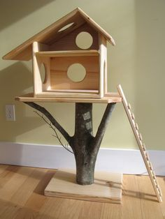 "Pinner stated: ""It said for a doll house. But through some carpet on there and you have an awesome cat condo."" A tree house for a cat:) #cats #CatTree #TreeHouse"