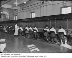 The evolution of placing a phone call - Switchboard operators at the Bell Telephone head office,1912