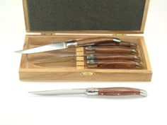"Fleur de Lys 6 Laguiole Rosewood handle knives by Arceau Marketing. $101.31. Beautiful rosewood and 420 steel. Matching serving tools available. Classic laguiole styling. Full bolster, not hollow with rivets. Guilloché (tooled) back tang. ""The Rosewood handles give these Laguiole knives a exotic and maritime look. The two solid stainless steel bolsters gives a solid feel in the hand. This model is enhanced with a guilloché (tooled) backtang adding a note of elegance. The ..."