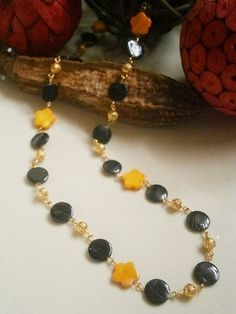 32 inch  BLACK and YELLOW MOTHER OF PEARL BEADED NECKLACE £10.00  http://folksy.com/items/4892972-32-BLACK-YELLOW-MOTHER-OF-PEARL-BEADED-NECKLACE