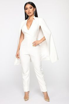 Available In White And Light BlueCape JumpsuitSleevelessShoulder PadsSurplice NeckSide Zip ClosureWide Leg PantsNon InseamSelf: Polyester SpandexLining: PolyesterImported Cape Jumpsuit, Jumpsuit Outfit, White Jumpsuit, White Dress, Bridal Pants, Wedding Jumpsuit, Vow Renewal Dress, Dinner Party Outfits, Bridal Cape