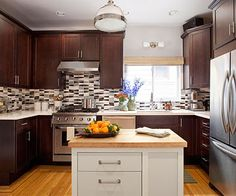 A narrow galley kitchen can be a challenge, but these layout and floor plan tips show you how to make the most of a tiny space.