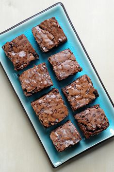 Don't let their crackly, craggy, salt-speckled tops fool you — below the surface is an insanely rich, fudgy, dense crumb that captures brownie batter's lush flavor and texture but is much easier to share with friends.