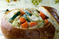 chicken stew with zucchini and carrots in a bread bowl