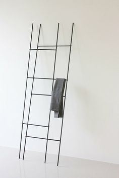 Thin black metal ladders