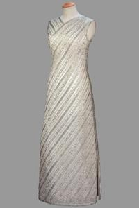 White crêpe shift with all-over diagonal stripes of silver lame and sequin embroidery    Norman Hartnell    Worn by Queen Elizabeth II for a performance by Kiri Te Kanawa in Dunedin, New Zealand, February 1963.