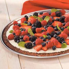 """Berry-Patch Brownie Pizza Recipe -""""I just love the combination of fruit, almonds and chocolate that makes this brownie so unique,"""" relates Sue Kauffman of Columbia City, Indiana. """"The fruit lightens the chocolate a bit and makes it feel like you are eating something sinfully healthy."""""""