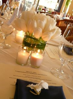 wedding flowers- Gorgeous French white tulips and some greenery. Nothing more needed for the most beautiful and elegant wedding setting ever. Tulip Centerpieces Wedding, Tulip Wedding, White Wedding Flowers, Wedding Decorations, Wedding White, Wedding Bouquets, Wedding Dresses, Wedding Table, Diy Wedding