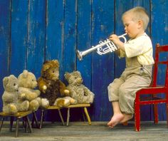 To take those fun stuffed animal pictures and help feed a child's love for music (or the idea of it)