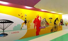 I like the FUN, colorful wall art. graphic-wall-design-airport-lyon