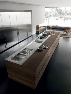 Love the light flowing into this kitchen..also so sleek