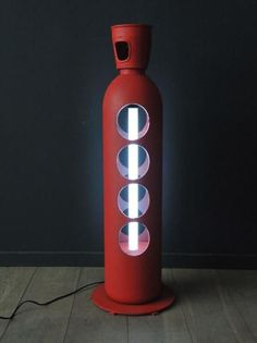 Light gaz cylinder Laser cutted into a gas cylinder and painted. This piece of art will be perfect for your designed appartment or house.