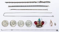 """Lot 562: Trifari Sterling Silver Brooch Pin by Alfred Philippe; Crown-shaped brooch adorned with rhinestones; together with a marked """"14k"""" gold wishbone pin as well as """"sterling"""" marked items including (3) bracelets, (2) necklaces, a charm and half dollar coins including 1962 Franklin, a 1964 Kennedy (90%) and (2) 1968 Kennedy (40%)"""