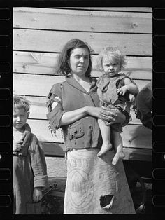 Mother and baby of family of nine living in field on U.S. Route 70 in Tennessee, near Tennessee River  Digital ID: (digital file from original neg.) fsa 8a01634 http://hdl.loc.gov/loc.pnp/fsa.8a01634