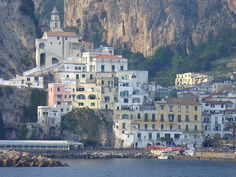 #Amalfi #Italy- A pretty little town  surrounded by #cliffs on the southern edge of the Amalfi #coast. Get some great #trip_ideas and start planning your next trip! See More: RoutePerfect.com