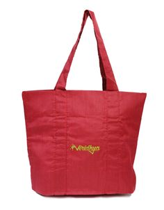 Eco-friendly shoulder bag in vivid red.  These bags are skillfully stitched by hand by women overcoming their distress in India, who wish to build up their own income to support themselves and their families. They are: •Eco-friendly (made from natural fibers). •Lightweight. •Reusable. •Made from a strong fabric. •Long lasting. •Can be easily and neatly folded away into a small space in your purse/briefcase/etc. •Easy to wash and dry quickly.