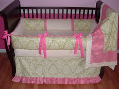 Stella Baby Bedding  Included in this set is the bumper, blanket, and crib skirt.  There is lots of detail in this custom set including  soft cream  minky, medium pink grosgrain ties, green and cream damask cotton, and medium pink stripe cotton print too.