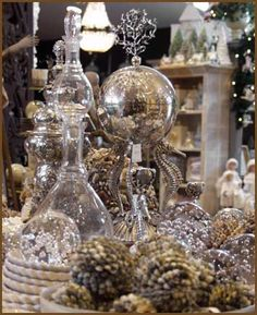 Dining room buffet...Use glitter houses, cloch, stacked plates, and crystal.