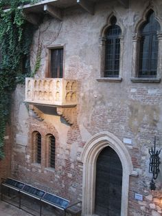 Juliet's Balcony, Verona, Italy.  You're supposed to stick a note to the wall with you and your beloved's names on it, for a lasting relationship.  (well, mine didn't last, and neither did my friend's, but we found other relationships that did!)