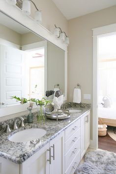 Cabinets are SW Dover White. The granite is Cambridge - Bathroom Granite - Ideas of Bathroom Granite - Wall color: SW Alabaster. Cabinets are SW Dover White. The granite is Cambridge White Granite. Faucets are by Moen. White Cabinets White Countertops, Paint Cabinets White, White Bathroom Cabinets, White Granite, Bathroom Vanities, Quartz Countertops, Bathroom Ideas, Bathroom Gray, Bath Ideas