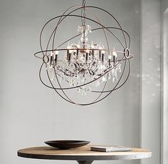 The Most Amazing Light Fixture Ever Industrial Looking Globe - Orb chandelier with crystals