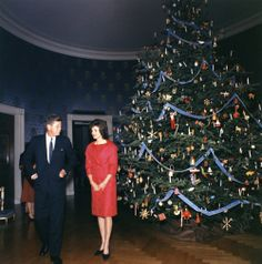 The President & First Lady pose by the Blue Room Christmas tree whilst attending the White House Christmas party honouring their staff ~ Dec. 1961