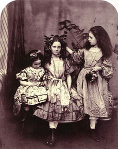 Alice and sisters / photo taken by Lewis Carroll?