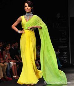 Malaika-Arora-Khan-in-Sweeping-Yellow-Gown-at-IIJW-2012.jpg (580×680)