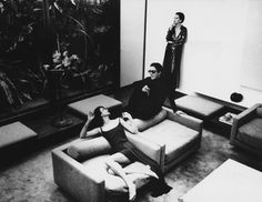 Halston in his E 63rd St townhouse circa 1975. Elsa Peretti is standing against the wall.