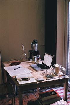 This is simply a well used desk. Although not very minimal, itnonethelessdepicts how environment lends itself to producing your best work. This owner is surrounded by all the creature comforts and you can tell he/she is really immersed in the task at hand.