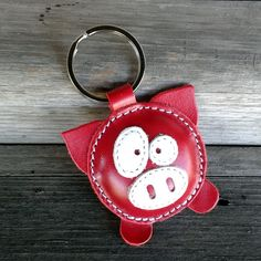 This cute little pig keychain is completely made of natural leather. Pig is… This cute little pig keychain is completely made of natural leather. Pig is filled with cotton wool to get look and soft touch. Leather Art, Leather Gifts, Leather Tooling, Leather Jewelry, Handmade Leather, Red Leather, Crea Cuir, Leather Projects, Leather Keychain