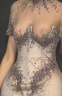 Alexander McQueen...you're drunk. you forgot a very important part of the dress...