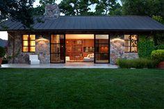 Sonoma Cottage, House, Exterior Stone Façade, Metal Roof, Modern Steel Sliding Doors