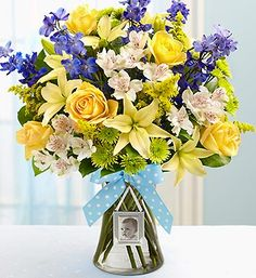 Sweet Baby Boy™ Arrangement- roses, lilies, delphinium, alstroemeria, poms, solidago and salal. Includes a keepsake magnetic mini photo frame and stylish ribbon. $49.99- $69.99 #newbaby #baby