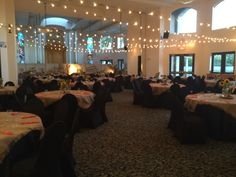 Western Event. Market lighting overhead to create a natural outdoorsy atmosphere. Burlap overlays with rustic cernterpieces. S'mores Bar, Hot beverage Bar, Food Stations, Photo ops, Country band.