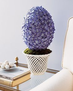 "Inspired by the jeweled treasures crafted by Peter Carl Faberge around the turn of the 20th century, this ""egg"" is decorated with spring-blooming hyacinths and pearl-headed pins. Created by Jennifer Pheiffer. http://www.marthastewart.com/268974/egg-shaped-hyacinth-topiary?czone=holiday/easter-center/easter-crafts-and-decor=276968=274918=268974"
