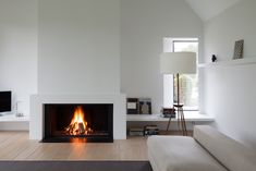 the white, contemporary interior design scheme creates a focal point of the frameless fireplace from Urban Fires Open Fireplace, Fireplace Surrounds, Fireplace Design, Electric Fireplace, Living Area, Living Room, White Interior Design, Contemporary Interior, Family Room