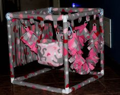 Sugar Glider Gyms are made out of PVC and fleece. They are 15x15 and come with 2 vines and 2 pouches and one toy such as a fleece ball with charms on plastic 3mm chain. All fleece items are sewn with hidden tight stitching so no toes get hung in them. 100% machine washable. Great for tent time or just sitting on the couch with your gliders on your lap with the glider gym. I have many different fleece patterns on hand.