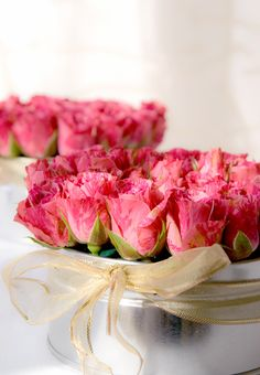 Pink marble roses in tin chocolate boxes