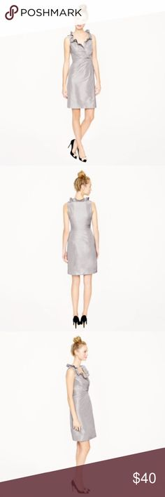 J. Crew Blakely Silver Cocktail Dress Sophisticated and elegant silver silk taffeta dress with romantic ruffled collar and fitted crossover bodice.  Minor stains (pinprick size) on the back of the dress (see photo) which can only be seen upon close inspection. J. Crew Dresses