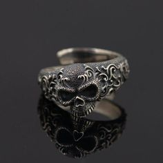 Commemorating the passage to the afterlife of Hel, The Warrior Lodge presents its Hel Collection, combining the beauty of Pure Sterling Silver with the most discerning aspect of death, the Grinning Skull. The ring is handcrafted of pure and certified 925 Sterling Silver. Surface Width: 13mm