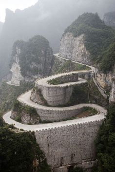 You just want to ride it. Wonder if anyone has ridden a bike on this road. Looks like the Great Wall . The spectacular winding road of Tianmen Mountain in Hunan Province, China (by GavinZ). Places Around The World, Oh The Places You'll Go, Places To Travel, Places To Visit, Around The Worlds, Wonderful Places, Beautiful Places, Amazing Places, Awesome