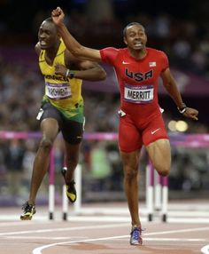 United States' Aries Merritt crosses the finish line ahead of Jamaica's  Hansle Parchment to win the men's hurdles final during the athletics in the  Olympic ...
